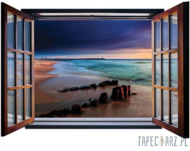 Fototapeta na flizelinie Zmierzch na plaży przez otwarte okno 1055